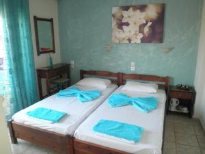 A bed or beds in a room at Babis