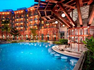 The swimming pool at or near Resorts World Sentosa - Hard Rock Hotel (SG Clean)