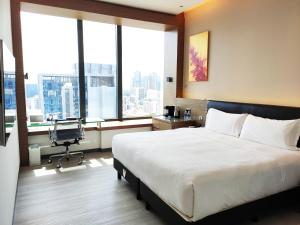 A bed or beds in a room at One Farrer Hotel (SG Clean, Staycation Approved)