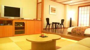 A television and/or entertainment center at Dogo Prince Hotel