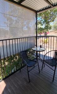 A balcony or terrace at Mt Larcom Tourist Park