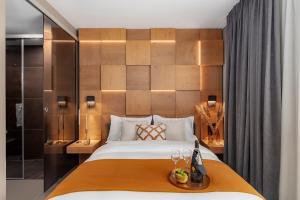 Een bed of bedden in een kamer bij VISIONAPARTMENTS Basel Nauenstrasse