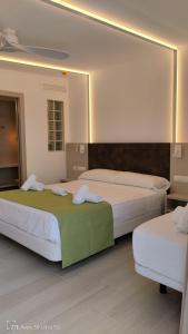 Letto o letti in una camera di Hotel Roca Bella