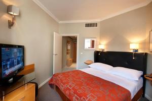 Łóżko lub łóżka w pokoju w obiekcie Golden Prague Residence