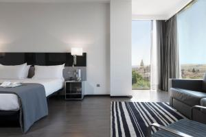 A bed or beds in a room at Eurostars Palace