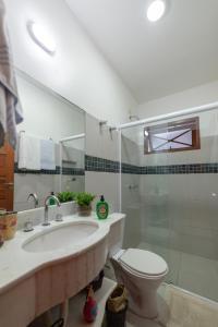 Um banheiro em Pousada Casario