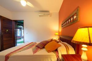 Cama ou camas em um quarto em Pousada Casario