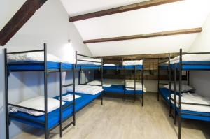 A bunk bed or bunk beds in a room at Kings Inn City Hostel