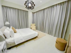 A bed or beds in a room at Dragon Hotel And Resort