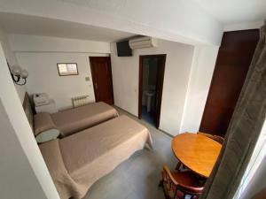 Cama o camas de una habitación en Pensión Eurosol