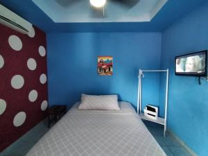 A bed or beds in a room at Hostal Monte Cristi