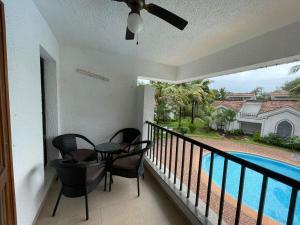 A balcony or terrace at Casa Legend Villa & Apartments Arpora - Baga - Goa