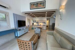 A seating area at Casa Legend Villa & Apartments Arpora - Baga - Goa