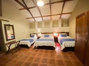 Cama o camas de una habitación en Hotel Boutique La Posada