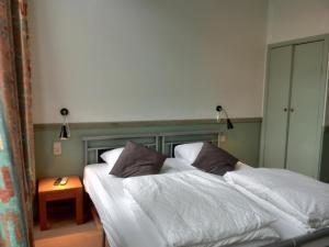 Кровать или кровати в номере Hotel Sabina