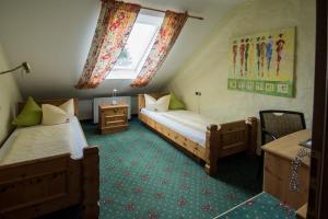 Ein Bett oder Betten in einem Zimmer der Unterkunft Avenue Altenfurt