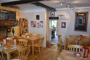 A restaurant or other place to eat at Cotswold Garden Tea Rooms