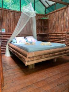 Cama o camas de una habitación en Mohagine Hotel