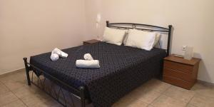 A bed or beds in a room at Small Village Residences