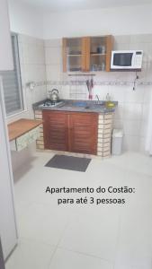 A cozinha ou cozinha compacta de De frente para o Mar da Gamboa