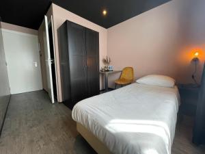 Un ou plusieurs lits dans un hébergement de l'établissement Hotel Restaurant Anno Nu