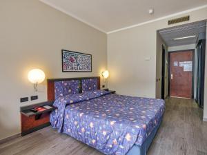 Ein Bett oder Betten in einem Zimmer der Unterkunft Hotel San Pietro