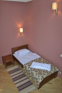 Ліжко або ліжка в номері Готель Золота Форель