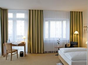 A bed or beds in a room at Albhotel Fortuna