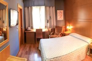 Cama o camas de una habitación en Reino de Granada