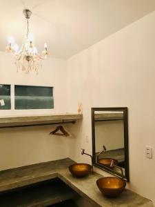 A kitchen or kitchenette at Suites Vida Sol