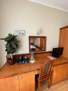 Telewizja i/lub zestaw kina domowego w obiekcie Hotelik City
