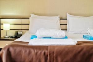 Кровать или кровати в номере Гостиница Распутин