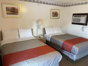A bed or beds in a room at Anson Inn