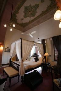 A bed or beds in a room at The Laxmi Niwas Palace