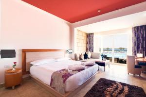 A bed or beds in a room at Barceló Tiran Sharm Resort