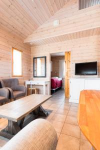 A seating area at Lapland Hotels Ounasvaara Chalets