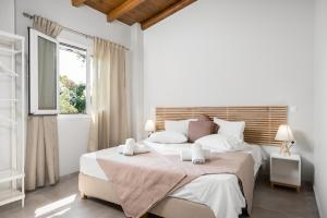 A bed or beds in a room at Folies Corfu Town Hotel Apartments