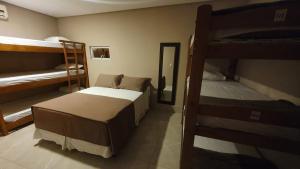 Uma ou mais camas em beliche em um quarto em Don Marco's Hotel