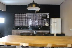 A cozinha ou cozinha compacta de Don Marco's Hotel
