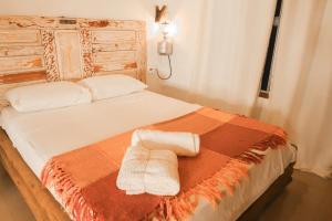 Cama ou camas em um quarto em Rancho das Estrelas