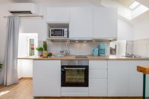 A kitchen or kitchenette at San Pietro apartment