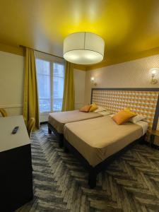 Un ou plusieurs lits dans un hébergement de l'établissement Hôtel Gérando
