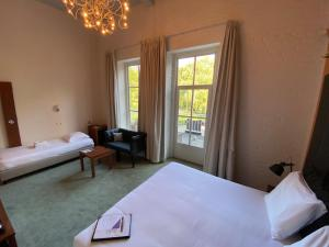 A bed or beds in a room at Leerhotel Het Klooster