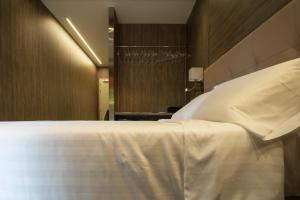 A bed or beds in a room at Hotel Tre Ville