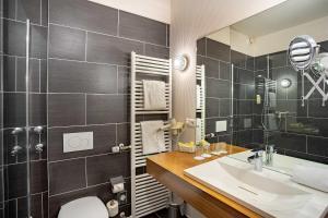 Ein Badezimmer in der Unterkunft Aqualux Wellness- & Tagungshotel