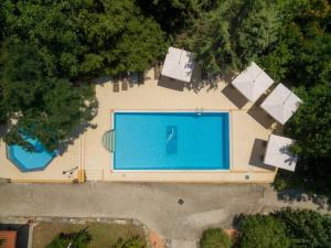 A view of the pool at Roxani Country House Resort or nearby