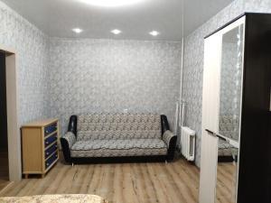 Гостиная зона в Apartament On Olimpiyskaya 85