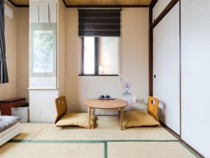 A seating area at Stay Inn KOTO
