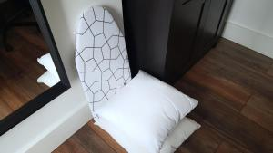 A bed or beds in a room at The Hide Away Modern Rooms