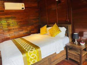 A bed or beds in a room at Prek Kdat Resort